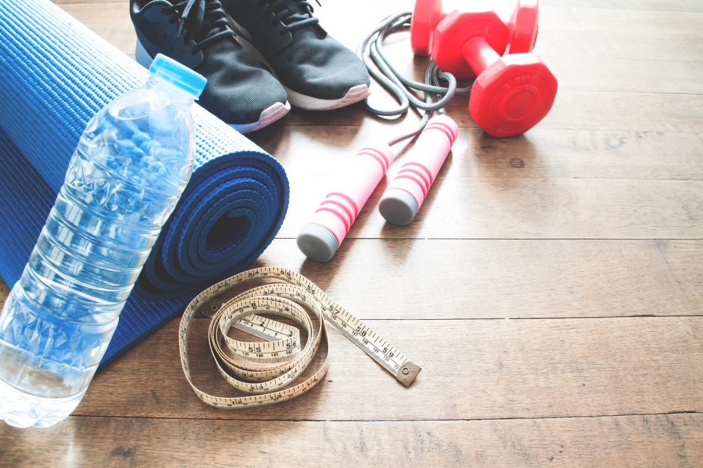 Sport equipments on wood floor, Working out concept